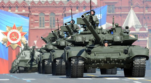 A column of Russia's T-90 tanks rolls at the Red Square in Moscow, on May 9, 2013, during Victory Day parade. Fighter jets screamed over Red Square and heavy tanks rumbled over its cobblestones as Russia flexed today its military muscle on the anniversary of its costly victory over Nazi Germany in World War II. AFP PHOTO / YURI KADOBNOV (Photo credit should read YURI KADOBNOV/AFP/Getty Images)